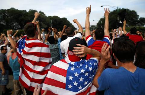 Fans celebrate the U.S. team's go-ahead goal at a USA-Portugal viewing party in Chicago.