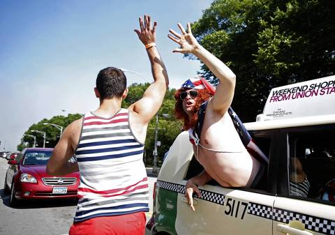 Fans high five before a USA-Portugal World Cup viewing party in Chicago.