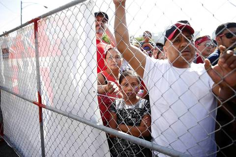 Eileen Gamez, 9, of Chicago and her family are shut out of the USA/Portugal World Cup viewing party, which was filled to capacity with thousands of soccer fans.