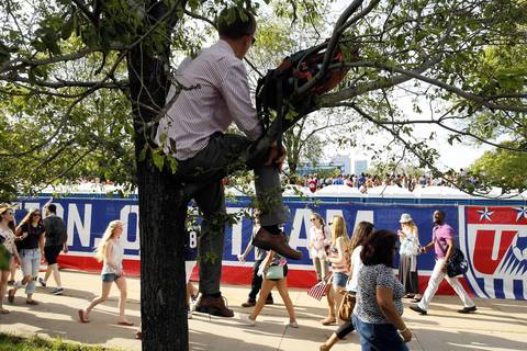 Brian Hunscher of Ann Arbor, Mich., watches the U.S.-Ghana game from a tree in Grant Park.