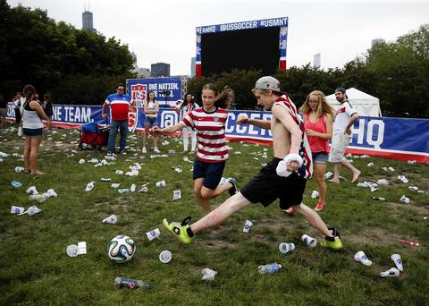 Phoebe Hillery, 11 of Plainfield and James Schulke, 19, of Chicago play soccer in Grant Park after watching a 2-1 win by the U.S. in a World Cup match against Ghana