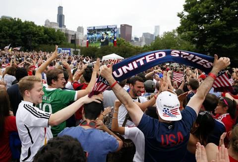 U.S. fans in Grant Park celebrate the U.S. team's win over Ghana.