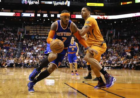 Carmelo Anthony of the New York Knicks drives the ball past Gerald Green of the Phoenix Suns.