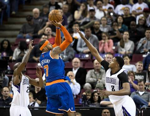 The New York Knicks' Carmelo Anthony scores over the Sacramento Kings' Rudy Gay.