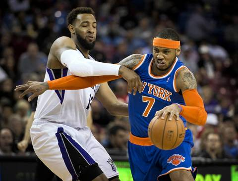 The New York Knicks' Carmelo Anthony drives against the Sacramento Kings' Derrick Williams.