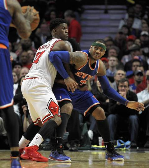 The Bulls' Jimmy Butler defends against the New York Knicks' Carmelo Anthony.