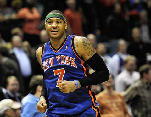 Knicks forward Carmelo Anthony was all amiles after the Knicks beat the Milwaukee Bucks 111-107 at the Bradley Center.