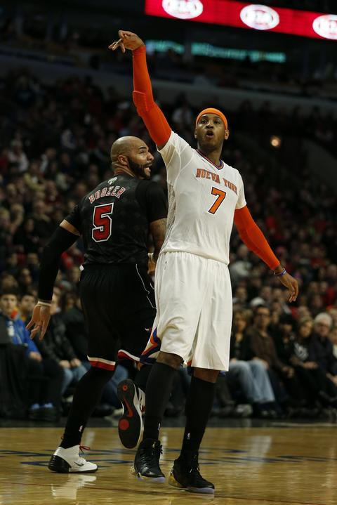 The Knicks' Carmelo Anthony follows through on a shot attempt against the Bulls at the United Center.