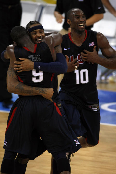 Carmelo Anthony hugs Dwyane Wade as Kobe Bryant celebrates the 118-107 win over Spain in men's basketball gold medal game at the Summer Olympics in Beijing.