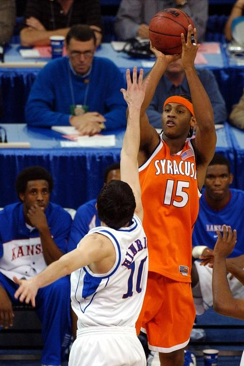 Syracuse's Carmelo Anthony shoots over Kansas' Kirk Hinrich during first half action of the NCAA Championship game at the Louisiana Superdome.