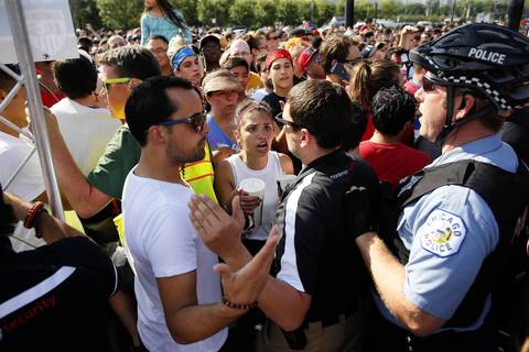Chicago Police restrict people from entering USA-Portugal World Cup viewing party along Balbo Avenue.