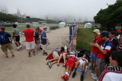 World Cup fans wait to get into Chicago's Grant Park to watch the U.S. take on Germany.