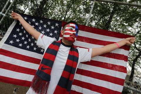 A World Cup fan shows off his U.S. allegiance as he waits to get into Chicago's Grant Park to watch the U.S. take on Germany.