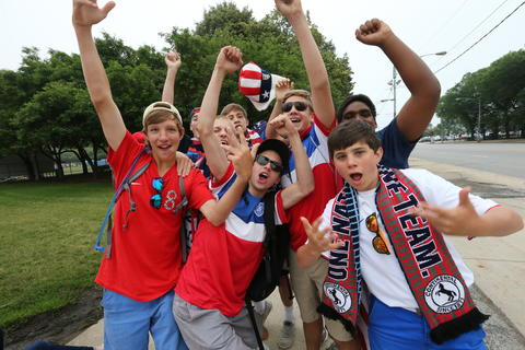 World Cup fans cheer for the camera as they wait to get into Chicago's Grant Park to watch the U.S. take on Germany.
