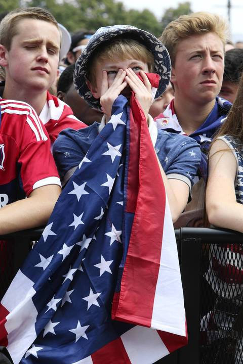 A World Cup fan at Grant Park in Chicago has a hard time watching game action during the match-up between the U.S. and Germany.