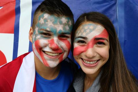 World Cup fans show off their U.S. allegiance as they wait to get into Grant Park in Chicago to watch the U.S. match against Germany.