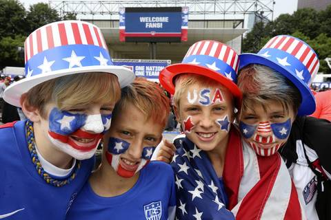 World Cup fans at Grant Park in Chicago show off their game faces as they wait to watch the U.S. match against Germany.
