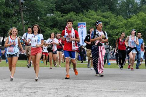 World Cup fans rush into Grant Park in Chicago to watch the U.S. match against Germany.