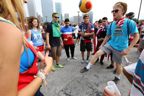 World Cup fans play a little at Grant Park in Chicago as they wait to watch the U.S. match against Germany.