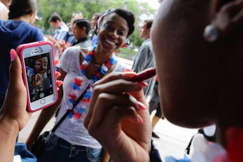 World Cup fans at Grant Park in Chicago get their game faces ready as they prep to watch the U.S. match against Germany.