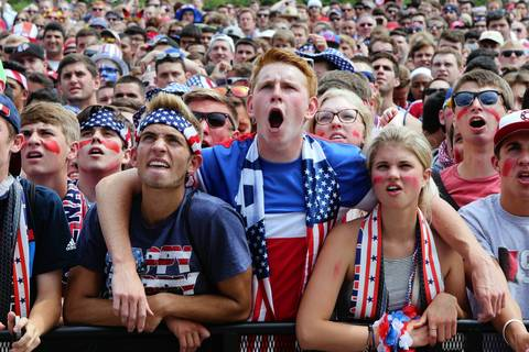 World Cup fans at Grant Park in Chicago react to game action during the match-up between the U.S. and Germany.