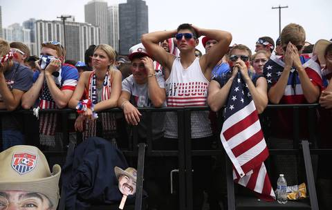 U.S. fans, at Grant Park in Chicago, react in disbelief after Germany scores early in the second half.