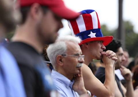 A U.S. fan, at Grant Park in Chicago, bites his nails while watching the U.S. play Germany in the World Cup.