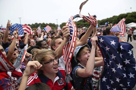 U.S. fans, at Grant Park in Chicago, celebrate the U.S. making it to the knock-out round of the World Cup.