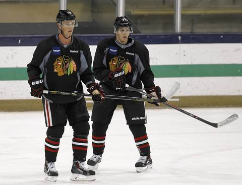 Blackhawks center Jonathan Toews (left) and Patrick Kane practice Sept. 12, 2013 at Notre Dame's Compton Family Ice Arena in South Bend.