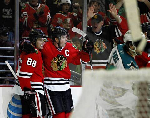 Blackhawks right wing Patrick Kane (88) and center Jonathan Toews celebrate a Toews goal against the San Jose Sharks on March 14, 2011.