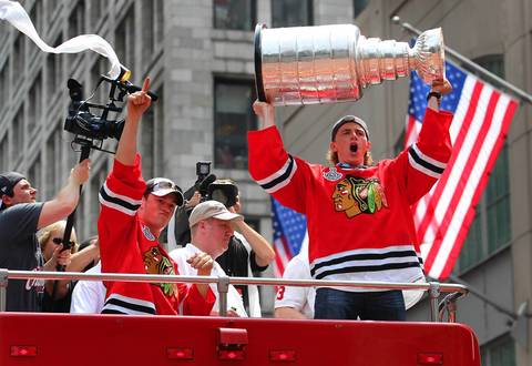 Jonathan Toews (left) and Patrick Kane celebrate with the Stanley Cup during a parade on June 11, 2010.