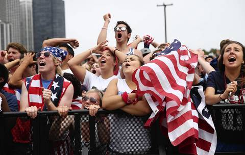 U.S. fans, at Grant Park in Chicago, react after the U.S. fail to equalize their World Cup game against Germany late in the second half.