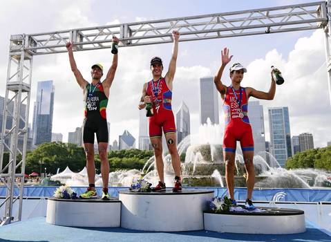 Joao Pereira, left, Portugal, second place, Javier Gomez Noya, of Spain first place and Mario Mola, of Spain, third place celebrate on the podium after the medal presentation, during the 2014 International Triathlon Union World Triathlon Series Elite race.