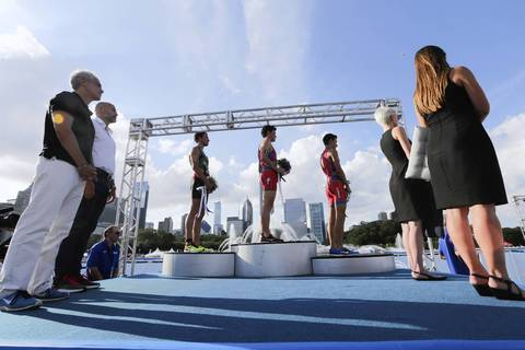 Chicago Mayor Rahm Emanuel, left, stands with the 2014 International Triathlon Union World Triathlon Series Elite race winner, as the spanish national anthem is played, in Grant Park.