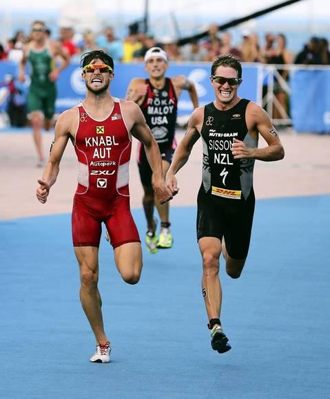 Alois Knabl, left, of Austria, Joe Maloy, of USA, and Ryan Sissons, of New Zealand, making their final push for the last few yards, at the finish line of the 2014 International Triathlon Union World Triathlon Series Elite race