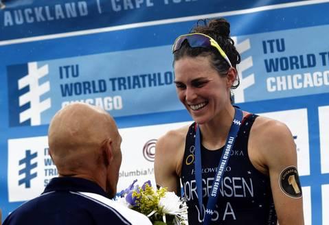 United States's Gwen Jorgensen accepts flowers after winning the International Triathlon Union's (ITU) World Triathlon Chicago.