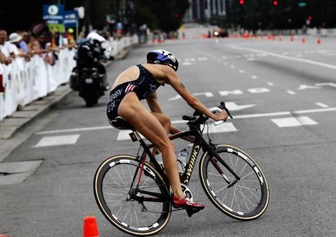 United States' Gwen Jorgensen turns onto South Columbus drive during the cycling portion of the International Triathlon Union's (ITU) World Triathlon Chicago.
