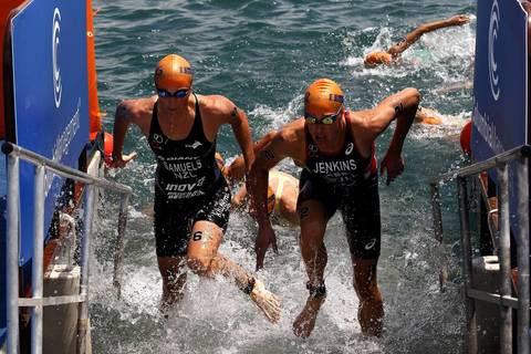 New Zealand's Nicky Samuels, left and Great Britain's Helen Jenkins race out of Lake Michigan during the swimming portion of the International Triathlon Union's (ITU) World Triathlon.