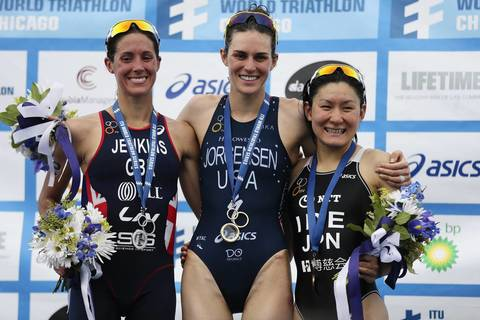 The United States' Gwen Jorgensen (1), at center, celebrates with Great Britain's Helen Jenkins (2) and Japan's Juri Ide during the awards ceremony following the International Triathlon Union's (ITU) World Triathlon Chicago.