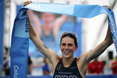 The United States' Gwen Jorgensen (1) celebrates after winning the International Triathlon Union's (ITU) World Triathlon Chicago.