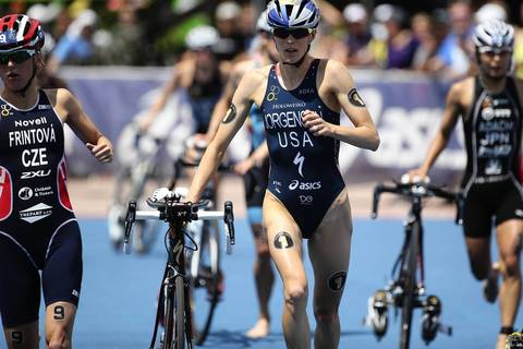 The United States' Gwen Jorgensen (1) runs to change into running shoes in the transition area after completing the cycling portion of the International Triathlon Union's (ITU) World Triathlon Chicago.
