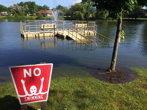 A dock in Bolingbrook is submerged in flood water.