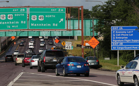 Westbound traffic stalls after Interstate 190 was reduced to a single lane at Mannheim Road due to standing water, prompting authorities to urge commuters to seek alternate routes to O'Hare International Airport today.