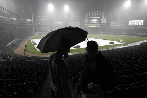 White Sox fans head out after the announcement was made that the game against the Los Angeles Angels was canceled due to stormy weather.