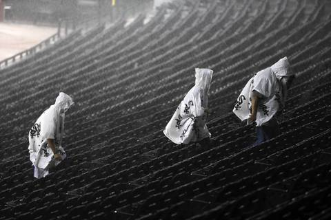 Fans head out at U. S. Cellular Field in Chicago after the game between the White Sox and the Los Angeles Angels was canceled due to stormy weather.