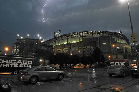 Lightning can be seen over U. S. Cellular Field in Chicago. The game between the Chicago White Sox and the Los Angeles Angels was canceled due too heavy rains and thunderstorms.