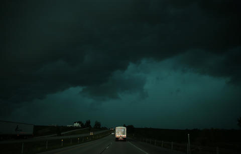 A storm moves east along Interstate 80 west of Iowa City, Iowa.