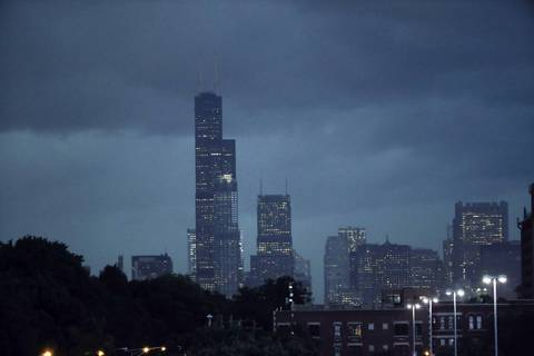 The Willis Tower is surrounded by clouds just before the rain arrived, downtown Chicago.