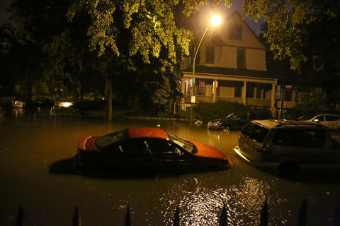 A street in the Lakeview neighborhood of Chicago is flooded from the severe storms that pummeled the Chicago area Monday.