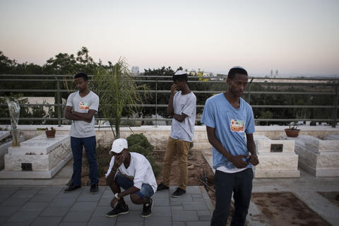 People mourn during the funeral ceremony held for the three Israeli teenagers found dead, on July 1, 2014 in Modiin, Israel. The bodies of Eyal Yifrah, 19, Gilad Shaar, 16, and Naftali Fraenkel, 16, were found on Monday, north of the Palestinian town Halhul, near Hebron. The teenagers were reported missing since June 12.